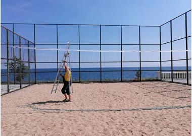 Renewing the volleyball net on the sports ground