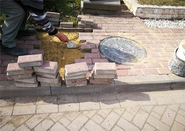 Restoration of paving slabs.